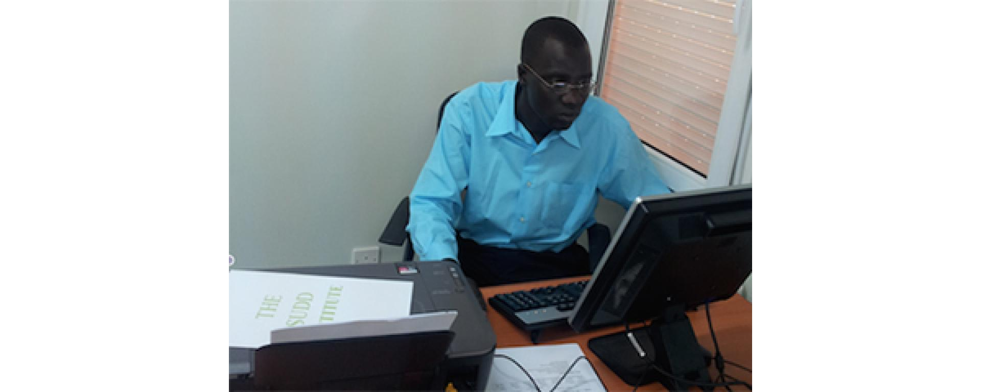August in the office : Dr Mayai in the Office